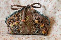 Little embroidered pouch with crochet top edge