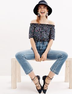 J.Crew Looks We Love: women's off-the-shoulder top in Ratti® Happy Cat print, Billie demi-boot crop jean in Surrey wash, sun-safe bucket hat, chambray crystal earrings and leather eyelet lace-up flats.