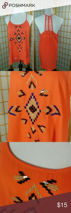 Alna Be flowy orange tank-top Alna be, flowy orange cage back tank top, with embroidered black blue, and gold sequin details. Very good used condition. Size Medium. Alna be Tops Tank Tops