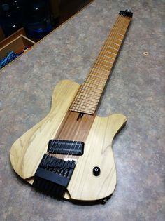 Oakland Axe Factory - A new prototype multiscale 8 string headless guitar. It features a bamboo neck thru like on several of my earlier erg builds and a Hipshot headless system. The pickup is Lace Death Bar and the body wood is poplar. The guitar is finished with a very thin satin lacquer.