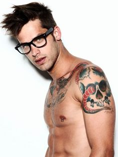 cute guy with tattoos.  they make him cuter to me otherwise he'd be too pretty haha