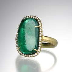 An yellow gold band with a center cabochon Brazilian emerald surrounded by 51 pave diamonds totaling With pave, stone measures high and wide. Jewelry Boards, Jewelry Rings, Fine Jewelry, Jewellery, Brazilian Emerald, Emerald City, Solitaire Ring, Envy, Gemstone Rings