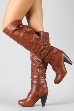 Knee high boots! these would be soo cute with some white skinny jeans!!!