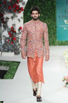 Love this coral orange sherwani from the collection Vintage Garden by Varun Bahl Indian Men Fashion, Mens Fashion Wear, Red Lehenga, Lehenga Choli, Sarees, Indian Groom Wear, Indian Wear, Wedding Sherwani, Sherwani Groom