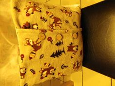 fleece rug made into cushion covers and i made the wooden buttons.