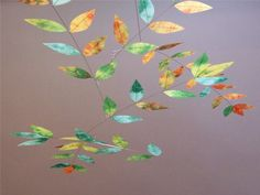This decorative mobile is made from hand dyed silk to achieve a mottled mix of colors that are reminiscent of changing leaves. Each leaf is