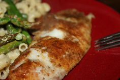spicy oven baked tilapia. Line pan with foil, then olive oil, tilapia, pats of butter on tilapia, then sprinkle generously with old bay and wrap in foil. Bake at 375 for 10-15 minutes