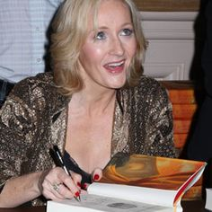 FAMOUS PEOPLE WITH DEPRESSION J.K. Rowling autographs a copy of her book.