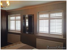 These shutters looks lovely in this classy bedroom