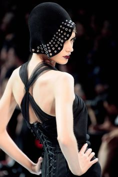 Dior retro fashion, with studded 1920's  cloche.  I chose this because it shows the type of headwear they wore