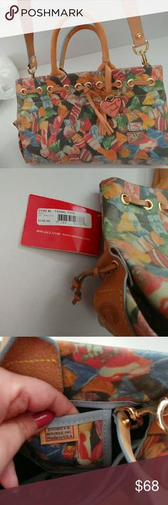 Dooney and Bourke handbag Sweet candy motif Dooney and Bourke. Nwt.  Purse measures 7x12.  Handles have a 4 inch drop and strap has a 19 inch drop Dooney & Bourke Bags Shoulder Bags