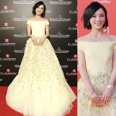 "Actress #YuanShanshan was stunning in #GEORGESHOBEIKA for the premiere of ""A Hero or Not"" at the 18th #ShanghaiInternationalFilmFestival. Yuan donned a yellow, off-the-shoulder princess cut ball gown with green embroidered petals on the skirt and a bowtie waist belt from Georges Hobeika's SS 15 #Couture collection."