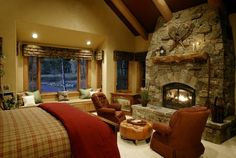 Love the rustic stone fireplace in the bedroom. Just something so sexy about a fire crackling...