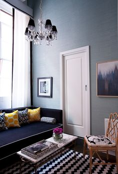 Madeline Weinrib Black & White Zig Zag Cotton Carpet, Saffron Mu and Black Luce Ikat pillows, room by Diane Bergeron