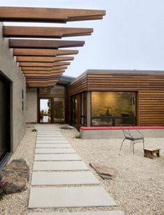 The wood cladding with the glazed corner would sit well in a garden environment