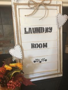 This simple and rustic Laundry Room sign is the perfect homey touch. Weathered looking white wood with burlap ribbon and bow accent. Paint color of your choosing for letters or hearts. Sign measures 11 1/2 inches by 18 1/2 in. Optional hooks on bottom of sign. Keep in mind these are made to order so if you would like your sign to say something else, just let me know!