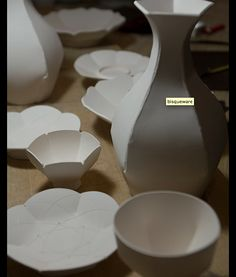 Derek Au - vase, plates, bowls from templates.  All from 1-2 slabs (folded 3D).