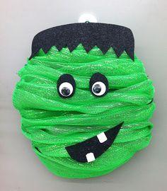 Halloween Frankie made with green mesh around a Styrofoam wreath, some felt and googlie eyes