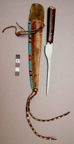 Knife and sheath collected at Standing rock, before 1883.  Peabody Harvard  ac