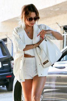 Vanessa Hudgens rocks summery white short-shorts and super long red nails.