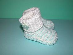 These fun booties are very soft and hand knitted with love and care. To keep those little toes comfy and warm indoors and out.  Yarn....Baby Cotton
