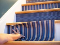 Add pattern and color to a staircase with wallpaper, acrylic sheeting and decorative hardware.