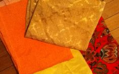 Cushion covers ready to sew. The usual warm palette for the living/dining area. All from the op-shops.
