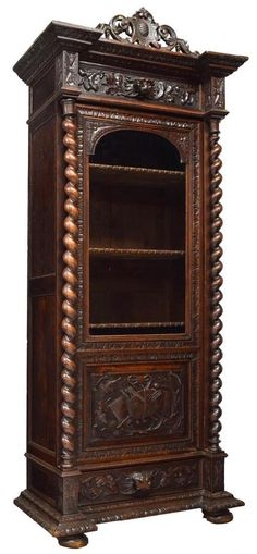 A French Renaissance Revival Carved Bookcase, 19th Century.
