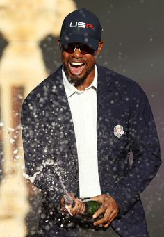 Vice-captain Tiger Woods of the United States celebrates during the closing ceremony of the 2016 Ryder Cup at Hazeltine National Golf Club on October 2016 in Chaska, Minnesota. Ryder Cup, Tiger Woods, Photo On Wood, Independence Day, Golf Clubs, Cool Pictures, Chaska Minnesota, Blazer, Shirt Dress
