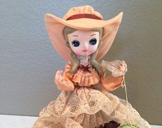 "Vintage Original 1978 Bradley Big Eyed  Doll with Peach and Lace  Southern Belle Dress and Hat on Plastic Stand 13"" Original Tags"