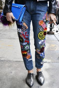 badge-adorned DKNY jeans