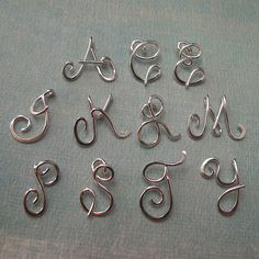 Small Calligraphy Initial Necklace in sterling silver.