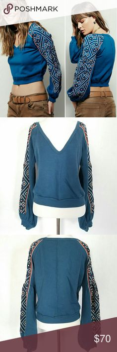 Free People Se?orita Top NWT BeautifulFree People se?orita v-neck top with embroidery detail on sleeves. Length is to the waist. Free People Tops