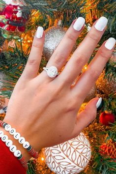 This oval diamond engagement ring features a double halo and split shank. Perfect for a holiday proposal! #oval #ovaldiamond #halo #doublehalo #diamond #splitshank #split #holiday #proposal #ido #shesaidyes