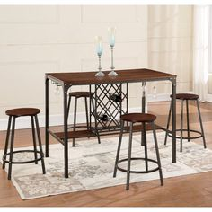 This bar table with wine rack serves the dual purpose of storing your wine and giving you a nice table to enjoy your cocktail and appetizers with family and friends. Finished in brown, this table comes complete with sleek metal brown legs, wood foot boards, wine rack and glass storage with 4 perfectly matching round stools. Great for the home entertainer.