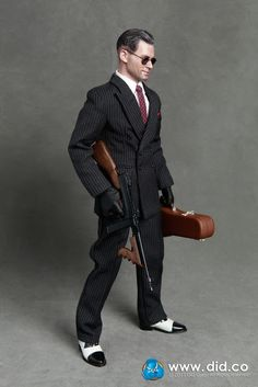 Public Enemies is a 2009 American biographical-crime film directed by Michael Mann and written by Mann, Ronan Bennett and Ann Biderman. Johnny Depp Public Enemies, Baby Face Nelson, Black Overcoat, Crime Film, Character Poses, Black Gloves, Money Shot, Double Breasted Suit, Toys For Boys
