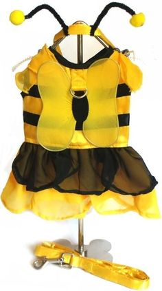 Bzzzzing,Bzzzzing Busy Honey Bumble Bee Sweet Bumblebee WInged Fairy Costume Dress Ensemble for your busy little pup. Includes one pet themed accessory Sizes: X-Small, Small, Medium and Large (See Size Chart Below) Features: Bumblebee Fairy in Yellow Satin Body Trimmed with horizontal Black banding. Adjustable Harness Dress styled costume for any ocassion. Adjustable Antennae Headpiece that can be worn separately. Includes one pet themed accessory Attached Yellow Opaque Wings Velcro Neck and…