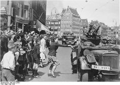 A Dutch woman welcoming German SS troops arriving in Amsterdam, the Netherlands, May 1940. Holland had an active Nazi party. During the war, Dutch Nazis collaborated closely with the Germans. A Dutch resistance developed almost immediately after the arrival of Hitler's troops.