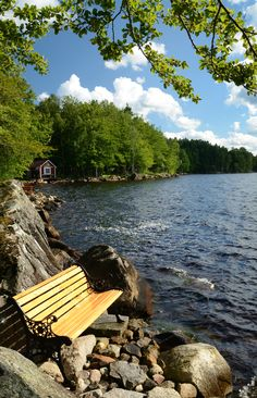 I don't know where this was taken, but it could have been in Muskoka, Ontario, Canada. Love the bench perched there on the rocks.
