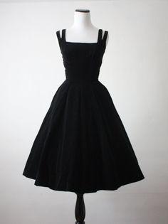 Vintage 1950s black velvet party dress with a full circle skirt.