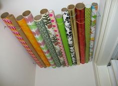 paper storage solution Wrapping paper storage solution--use wire and store it in a closet near the ceiling!Wrapping paper storage solution--use wire and store it in a closet near the ceiling! Wrapping Paper Rolls, Wrapping Papers, Gift Wrapping, Genius Ideas, Amazing Ideas, Cheap Storage, Creative Storage, Storage Organization, Storage Ideas