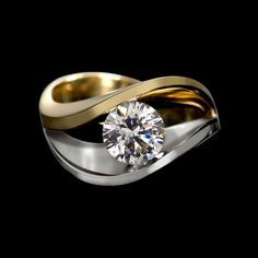 A modern engagement ring design by Adam Neeley.  Covet duo diamond ring is curvaceous and enchanting. A ring to treasure. This setting in two tones of gold features sweeping curves, dramatically presenting your center stone.