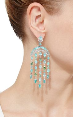 Delicatedly embellished with white diamonds, these scintillating earrings feature glistening paraiba tourmalines cascading throughout.