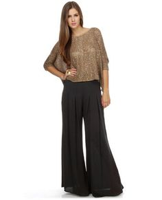 Flowing wide leg pants would look good  with any style top