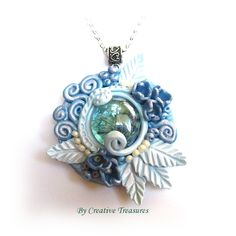 Blue Polymer Clay Sculpted Pendant with Glass Nugget. Very pretty.