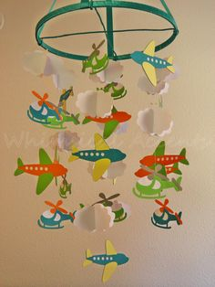 Airplane, Helicopter and Cloud Baby Paper Mobile in Teal. $75.00, via Etsy.