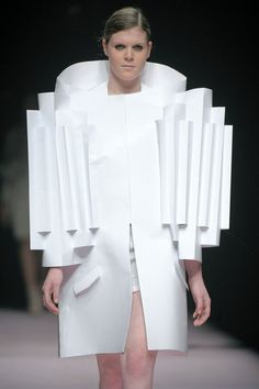 Alexandra Verschueren // collection that revolved around the designer's medium, paper // inspired by the work of artist Thomas Demand, folded and cut fabric like paper