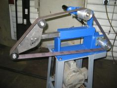Homemade 2x72 belt grinder fabricated from steel. Belt tension is maintained by a gas strut.
