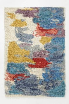 Thinking that I really like this rug look - maybe a tshirt latch hook rug?