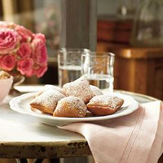 New Orleans Beignets | If you've never been to New Orleans, you can still get a taste of its cuisine with our recipe for New Orleans Beignets, the official state doughnut of Louisiana. | SouthernLiving.com